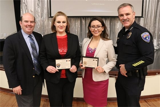 Sahuarita Mayor Tom Murphy and Police Chief John Noland pose for photo with award winners Holly Graves and Julie Rosales.