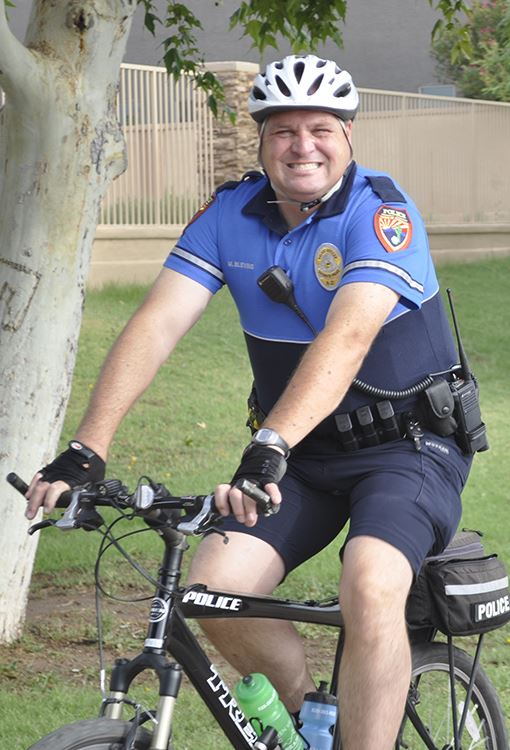 Police officer riding bicycle
