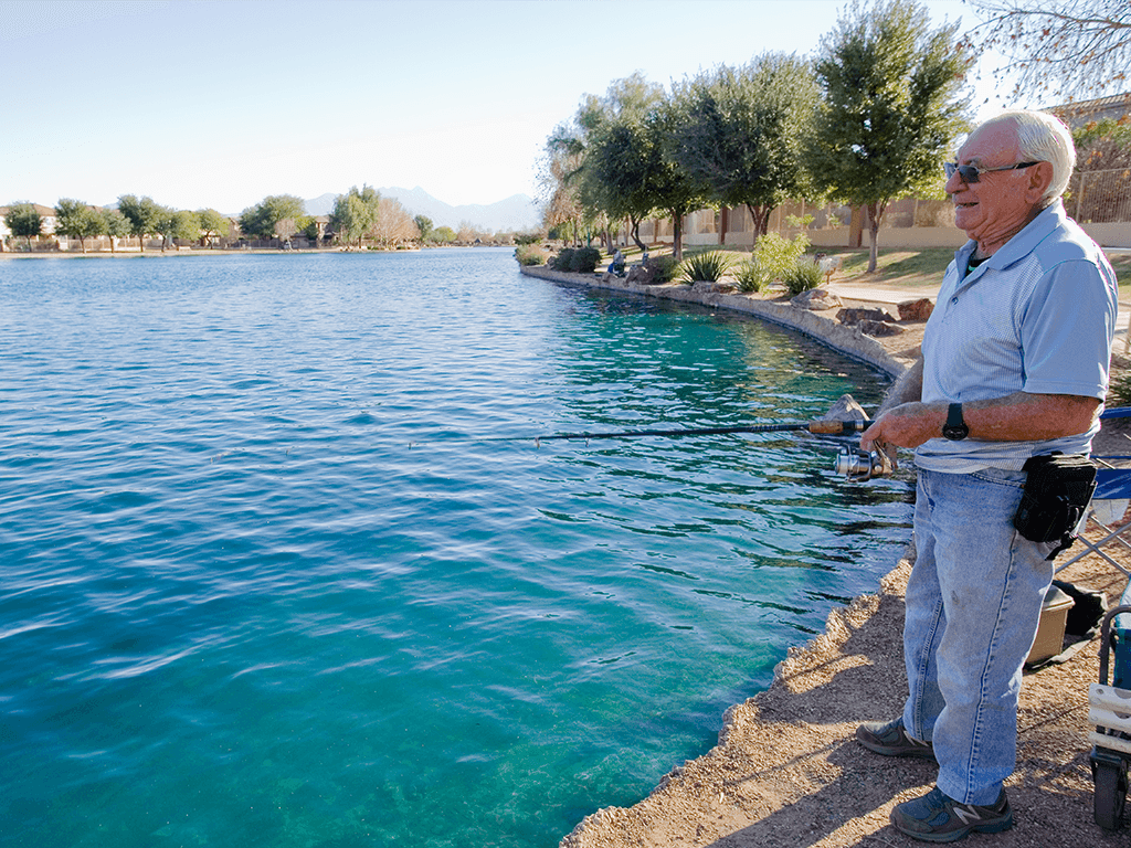 Man Fishing with a Smile at Sahuarita Lake Park