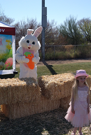 Easter Bunny with girl standing in front